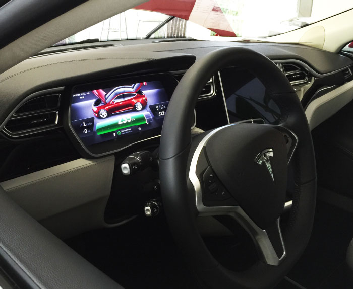 Behind the Tesla wheel.